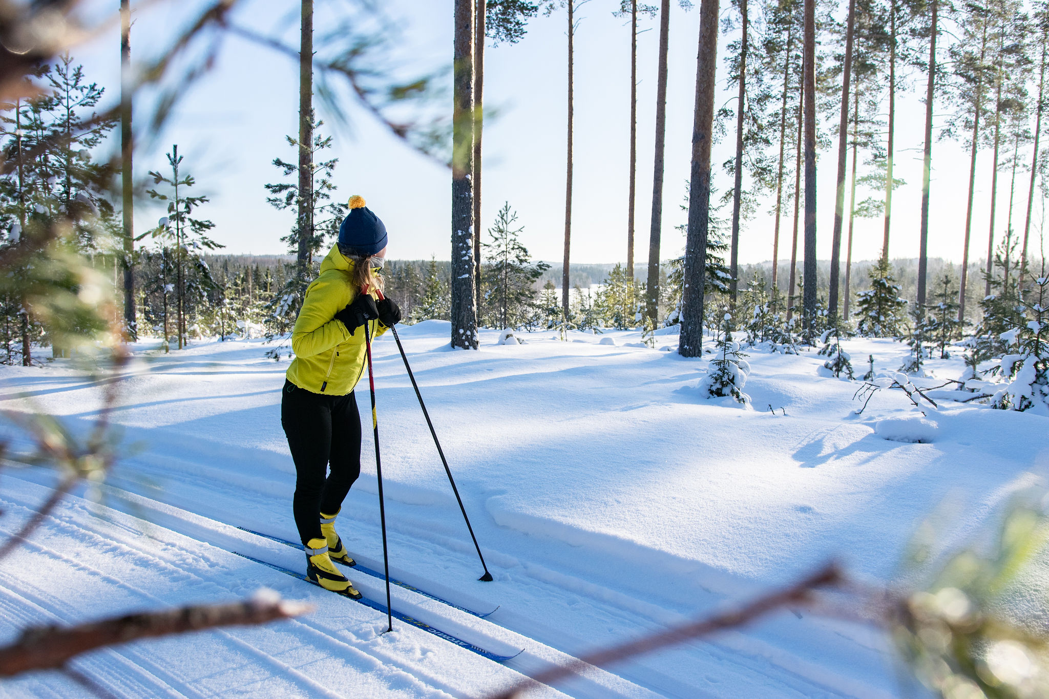 SaimaaLife Mari doing cross country skiing at Lomalehto cottages winter forests