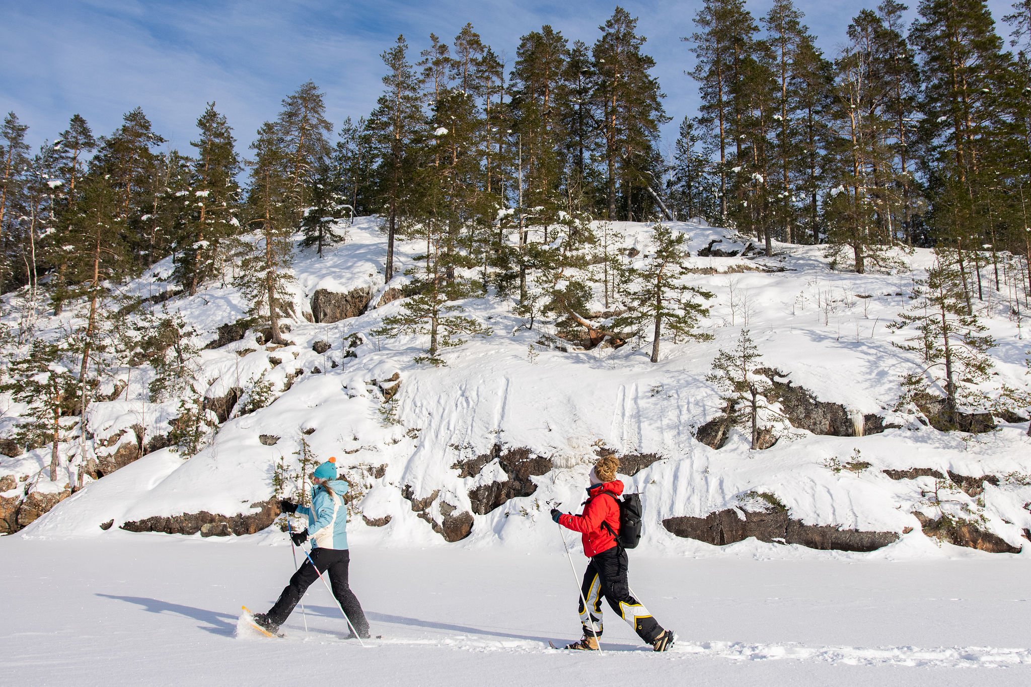 Winter snowshoeing on lake at Lomalehto Cottages in Saimaa, Finland