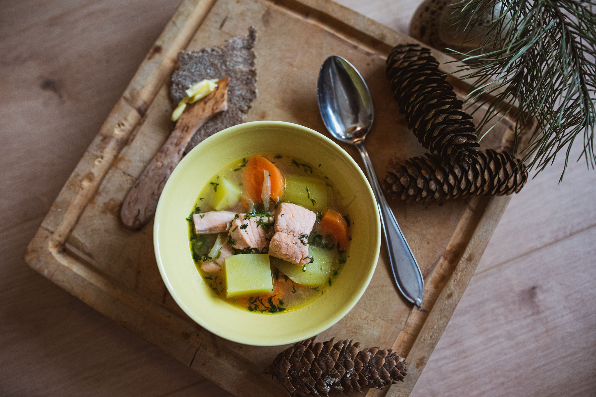 Paula's traditional salmon soup recipe with Finnish homemade rye cracker