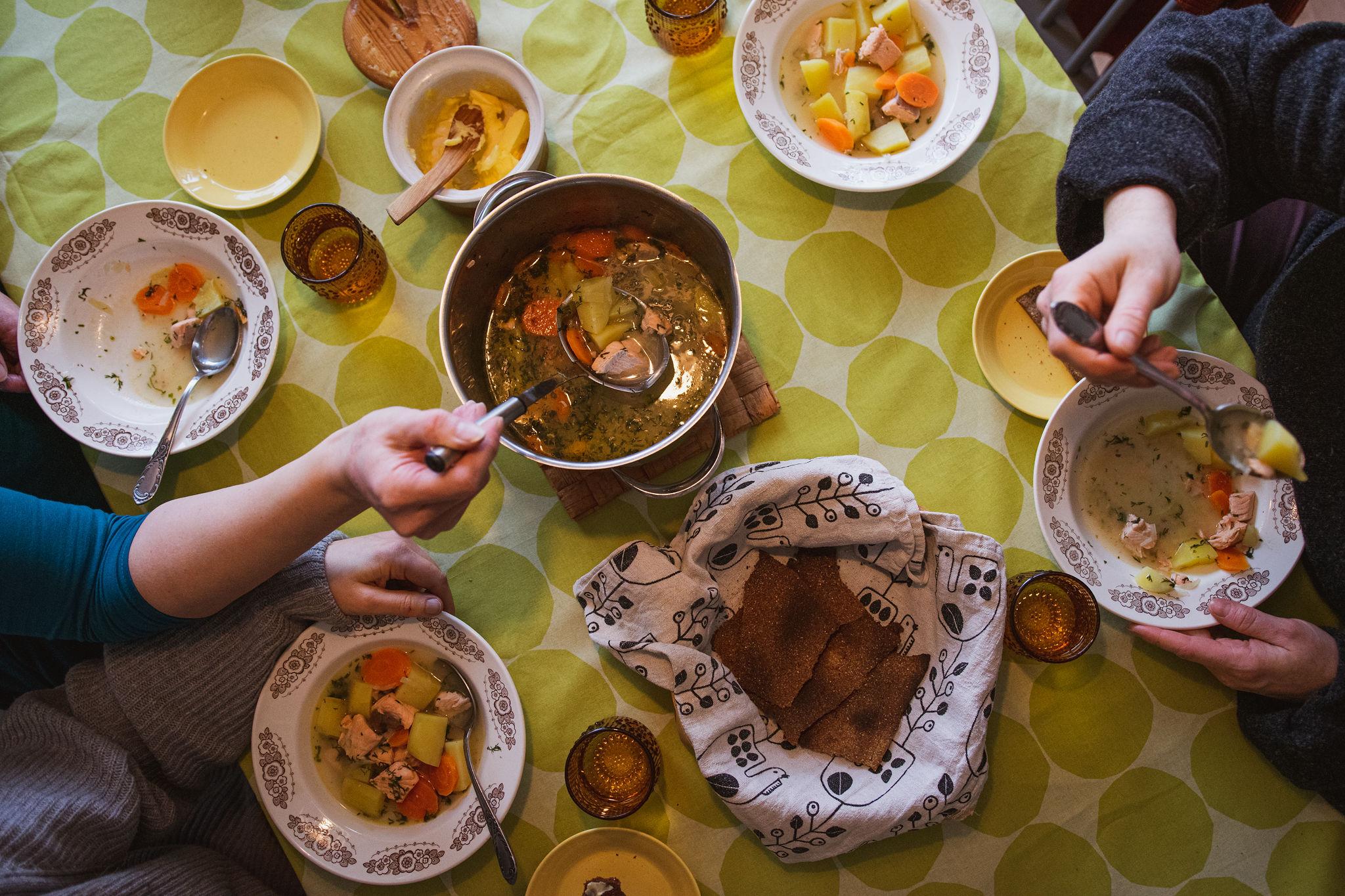 saimaaLife ladies enjoying traditional Finnish salmon soup with rye cracker