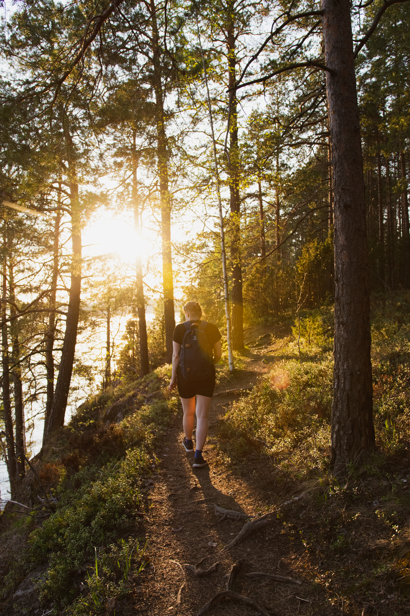 Woman walking in the spring nature in Saimaa, Finland
