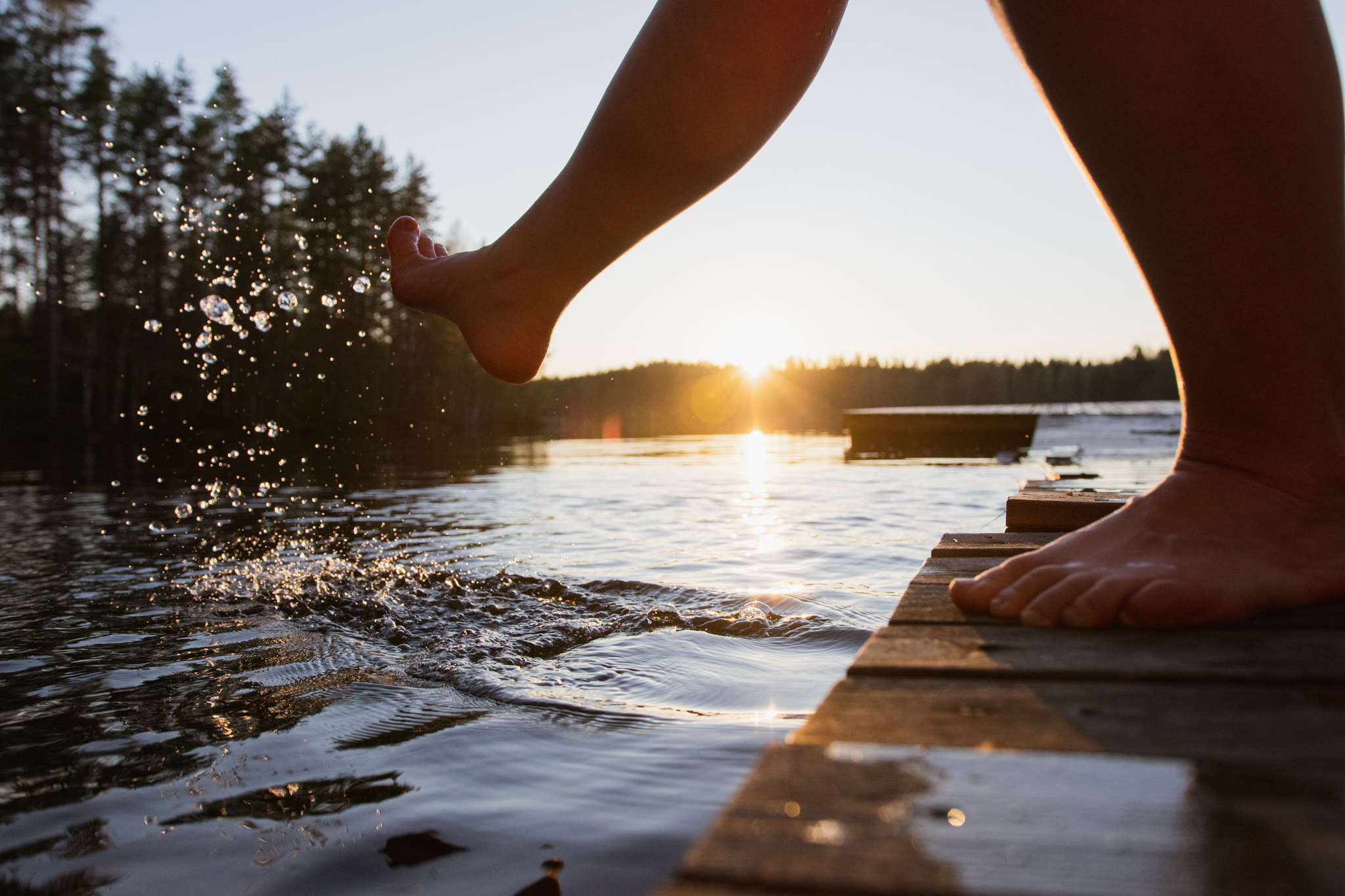 Finnish summer ways to connect with nature and yourself by looking at the sunset by the water