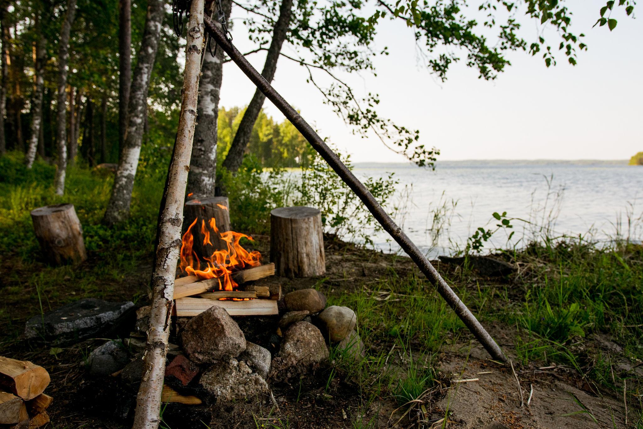 lakeside summer campfire in saimaa, finland