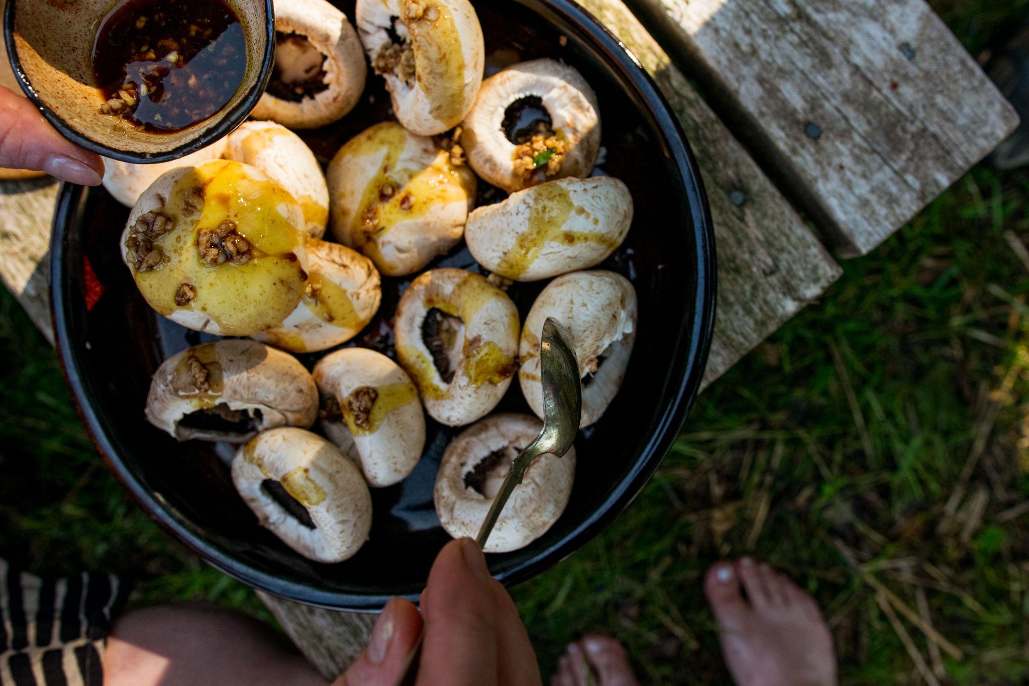 marinating the saimaalife grilled mushroom skewers